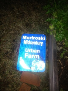 Farm sign that needs to be reattached to the fence now that it's stopped raining again (thanks, Fred & Christine!)