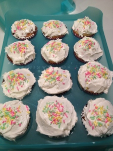 white cupcakes, decorated and ready to go