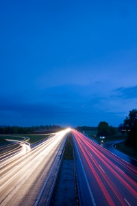 blurs of cars moving on a freeway
