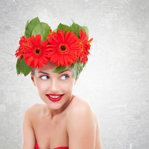 bigstock-young-woman-with-red-gerbera--45048136